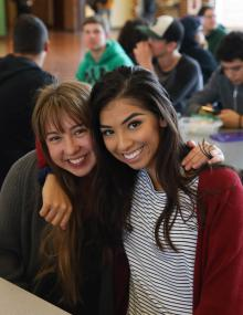 Two high school girls smiling